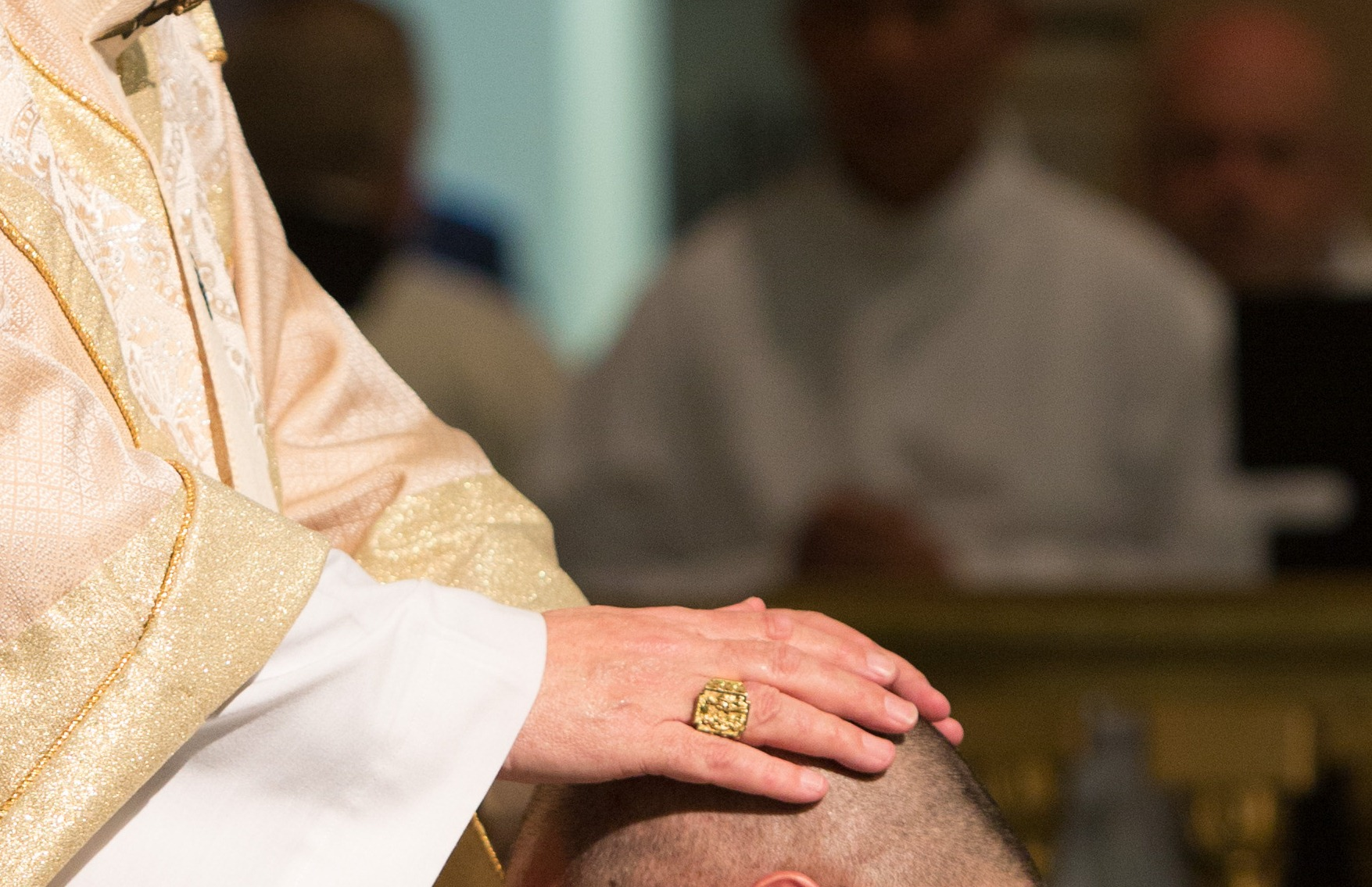Picture shows the Ordaining Bishop laying his hands on the candidate to be ordained a deacon